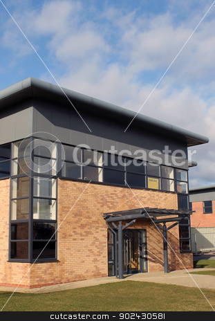 Empty modern office building stock photo, Empty modern office building on business park, blue sky and cloudscape background. by Martin Crowdy