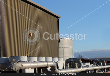 Exterior of modern factory building stock photo, Exterior of modern factory building with external pipe. by Martin Crowdy