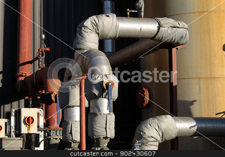 Industrial building exterior stock photo, Exterior of industrial factory building with pipes and lagging. by Martin Crowdy