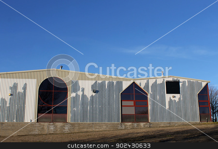 Modern factory building stock photo, Exteror of old modern factory building with blue sky background. by Martin Crowdy