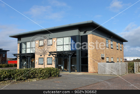 Modern office building stock photo, Exterior of empty modern office building in business park. by Martin Crowdy