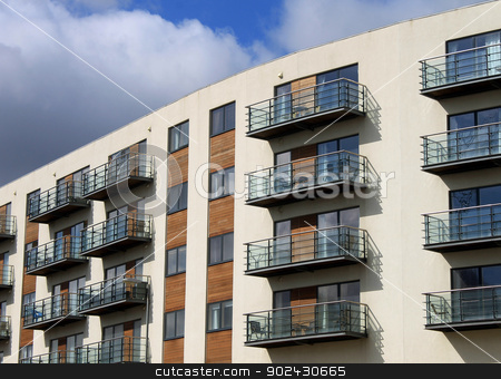 Modern vacation apartment building stock photo, Exterior of modern vacation apartment building, summer scene. by Martin Crowdy
