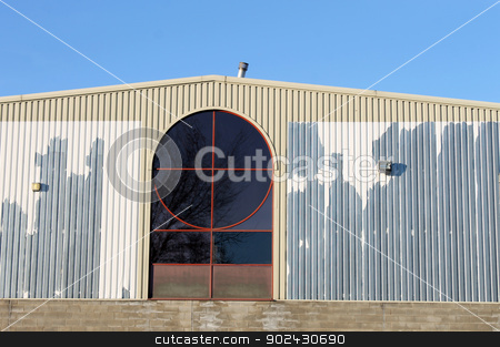 Old factory building stock photo, Exterior of old factory building with blue sky background. by Martin Crowdy