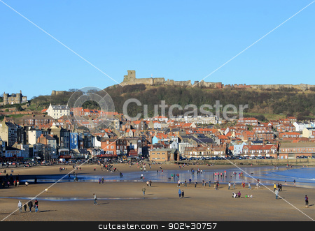 Scarborough Castle and beach stock photo, Scenic view of Scarborough castle and beach, North Yorkshire, England. by Martin Crowdy