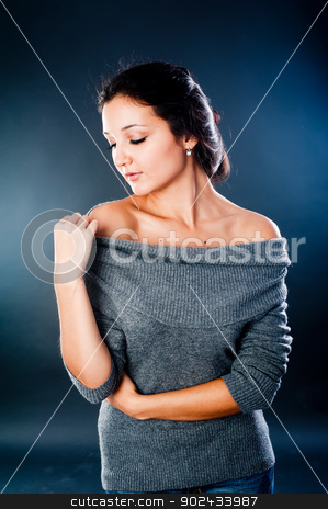 Pretty woman stock photo, Portrait of beautiful young woman at black background by Aikon