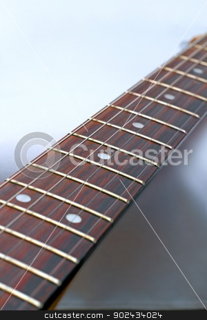 electric guitar detail stock photo, electric guitar - detail of the fret board with shallow depth of field by coroiu octavian