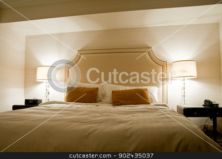 Bedroom stock photo, Bed and lamps by Jaime Pharr