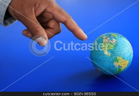 Globe stock photo, Image of a globe and hand with blue background by zuzanaderek