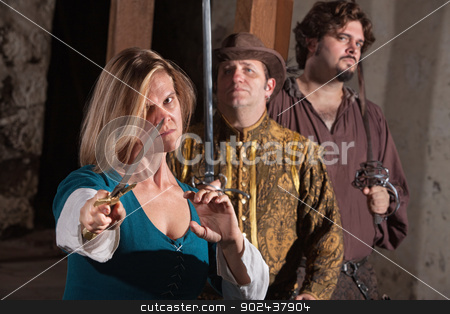 Serious Woman with Dagger stock photo, Serious Renaissance lady on guard with dagger and friends by Scott Griessel