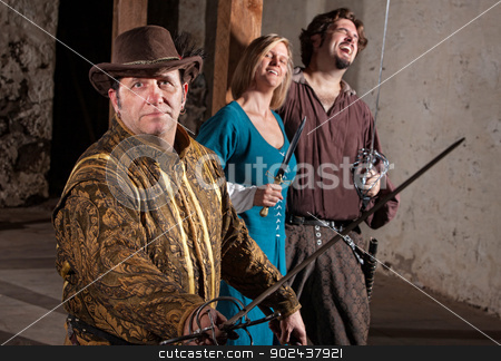 People Laughing at Sword Fighter stock photo, People laughing at swordsman with hat in middle ages character by Scott Griessel