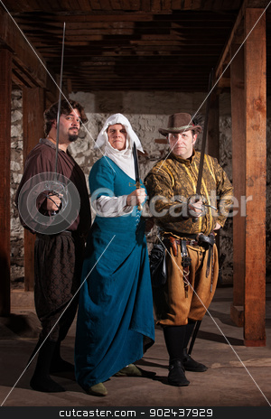 Tough Nun with Swordfighters stock photo, Two renaissance knights with nun carrying weapons by Scott Griessel