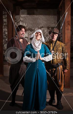 Swordsmen Teasing Nun stock photo, Two renaissance character men teasing righteous nun by Scott Griessel