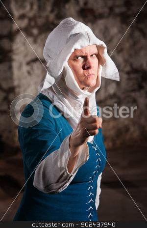 Angry Nun Pointing Finger stock photo, Angry European renaissance nun with pointing finger by Scott Griessel