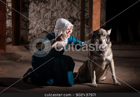 Nun Talking to Dog stock photo, Middle ages nun dog owner talking to her pet by Scott Griessel