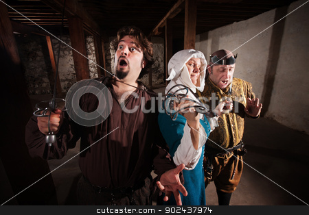 Nun Fighting Two Men stock photo, Brave middle ages nun with weapons on two men by Scott Griessel