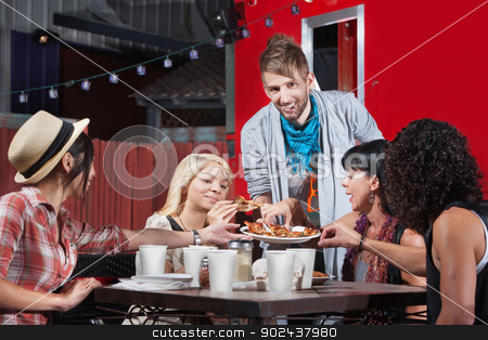 Man Serving Pizza to Friends stock photo, Smiling hipster serving pizza to group outside by Scott Griessel