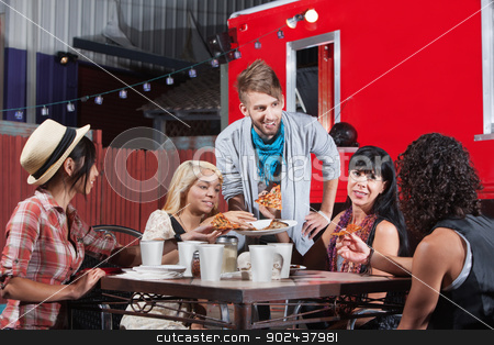 Mixed Group Eating at Restaurant stock photo, Mixed group of friends talking and eating pizza by Scott Griessel