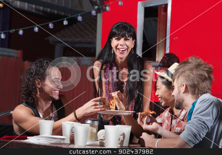 Pizza Dinner at Food Truck stock photo, Mature woman with younger group eating pizza by Scott Griessel