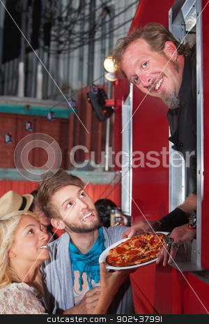 Chef with Pizza at Food Truck stock photo, Smiling Chef holding pizza with teenage couple by Scott Griessel