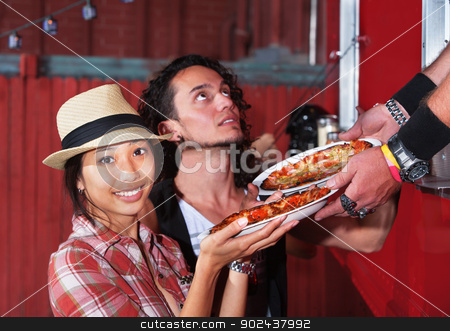 Cute Woman with Pizza Order stock photo, Cute Asian woman with carryout pizza from food truck by Scott Griessel