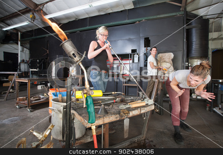 Distracted Glass Workers stock photo, Distracted worker looking at co-worker from behind in glass factory by Scott Griessel