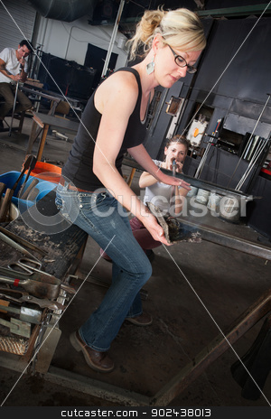 Glass Manufacturing Business stock photo, People working at a glass manufacturing business by Scott Griessel