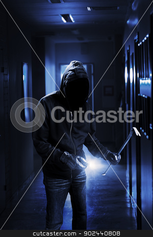 Burglar stock photo, Burglar with flashlight and crow bar in a dark office building. by Stocksnapper