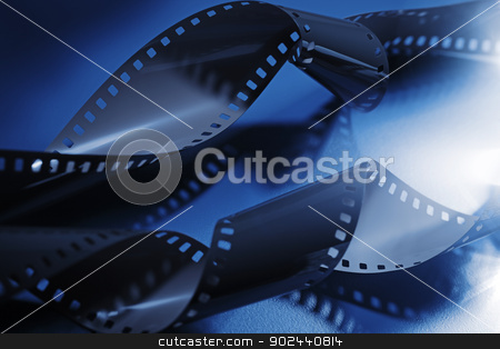Film stock photo, Monochrome blue image of 35mm photo or movie film. by Stocksnapper