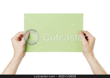Green Message stock photo, Man holding a blank light green paper against white background. by Stocksnapper