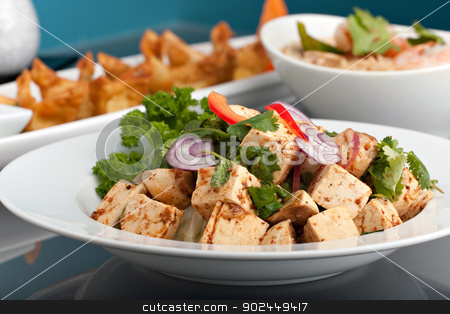 Thai Food Variety stock photo, A variety of Thai foods soup and appetizers presented beautifully with fancy garnish on a table. by Todd Arena