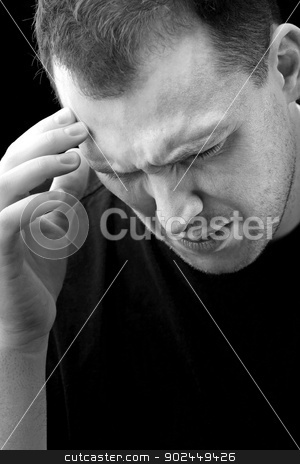 Man With Headache or Migraine Pain stock photo, A man with an intense headache or migraine in black and white. He might be experiencing stress during a time of economic crisis or other hardship. by Todd Arena