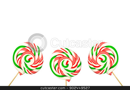 Three sugar lollipops in white green and red isolated on white b stock photo, Three sugar lollipops in white green and red isolated on white background by velislava