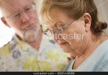 Senior Adult Male Consoles Sad Senior Adult Female stock photo, Senior Adult Man Consoles Sad Senior Adult Female. by Andy Dean