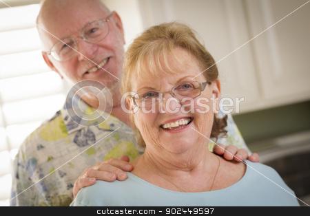 Happy Caucasian Senior Couple Portrait Inside stock photo, Happy Caucasian Senior Couple Portrait Inside Kitchen. by Andy Dean