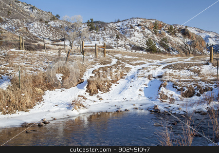ranch road crossing stream stock photo, ranch road crossing stream in a mountain valley, winter scenery, Eagle Nest Rock Open Space, Larimer County, Colorado by Marek Uliasz