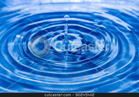 Water drop stock photo, Water drop falling down and splashing on the water surface. by MarcinSl1987