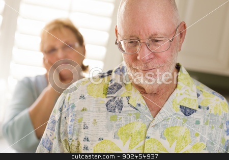 Senior Adult Couple in Dispute or Consoling stock photo, Senior Adult Couple in Dispute or Consoling in Kitchen of House. by Andy Dean
