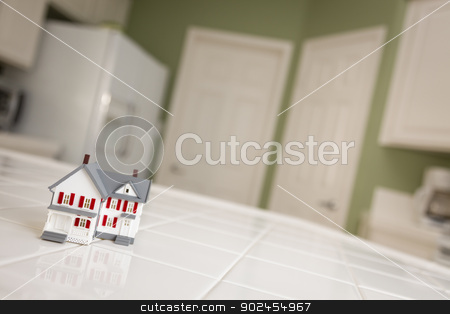 Small Model Home on Kitchen Counter of House stock photo, Small Model Home Sitting on Kitchen Counter of House. by Andy Dean