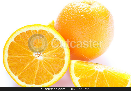 Whole and Half Orange on White stock photo, whole and cut oranges on a white counter by Darryl Brooks
