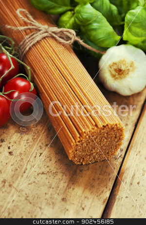 whole wheat spaghetti  stock photo, whole wheat spaghetti with ingredients by klenova
