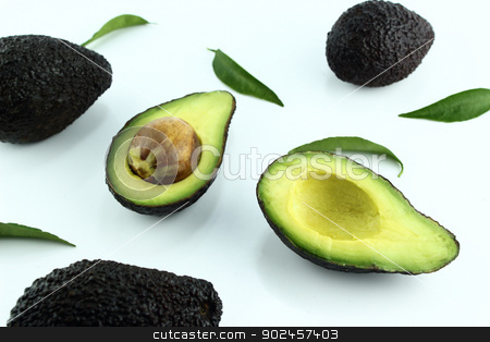 Avocados stock photo, Black Ripe Avocados with leaves on white Background. by Designsstock