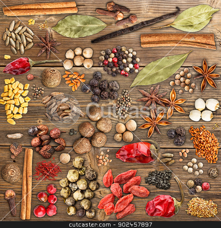 Various spices stock photo, Various spices on a wood background by Grafvision