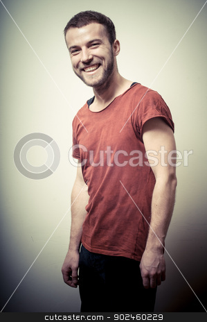 vintage portrait of smiling fashion guy stock photo, vintage portrait of smiling fashion guy on gray background by Eugenio Marongiu