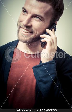 vintage portrait of fashion guy on the phone stock photo, vintage portrait of fashion guy on the phone on gray background by Eugenio Marongiu