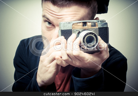 vintage portrait of fashion guy with old camera stock photo, vintage portrait of fashion guy with old camera on gray background by Eugenio Marongiu