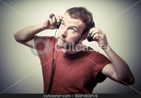 vintage portrait of fashion guy with headphones stock photo, vintage portrait of fashion guy with headphones on gray background by Eugenio Marongiu