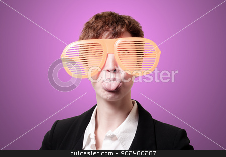 businesswoman with big funny eyeglasses and tongue out  stock photo, businesswoman with big funny eyeglasses and tongue out on pink background by Eugenio Marongiu