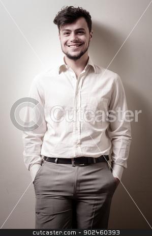 stylish modern guy with white shirt  stock photo, stylish modern guy with white shirt on gray background by Eugenio Marongiu