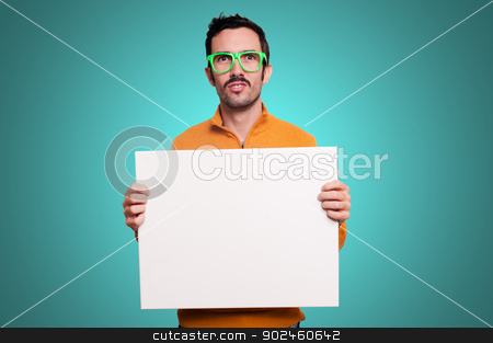 man holding blank white board stock photo, man with orange sweater holding blank white board on blue background by Eugenio Marongiu