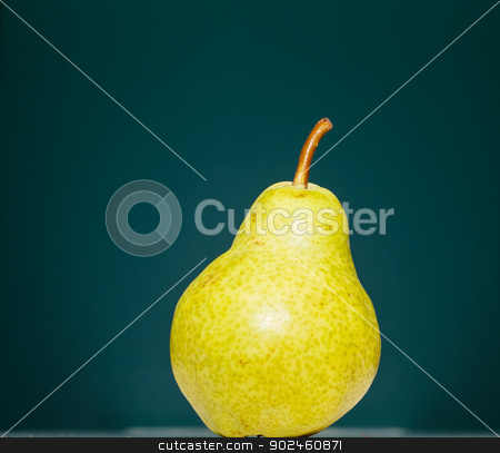 Green Pear on Green Background stock photo, A green Bartlett pear on a green background by Darryl Brooks